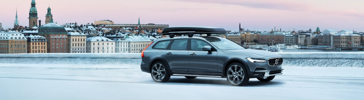 New Volvo V90 Cross Country sitting above the city
