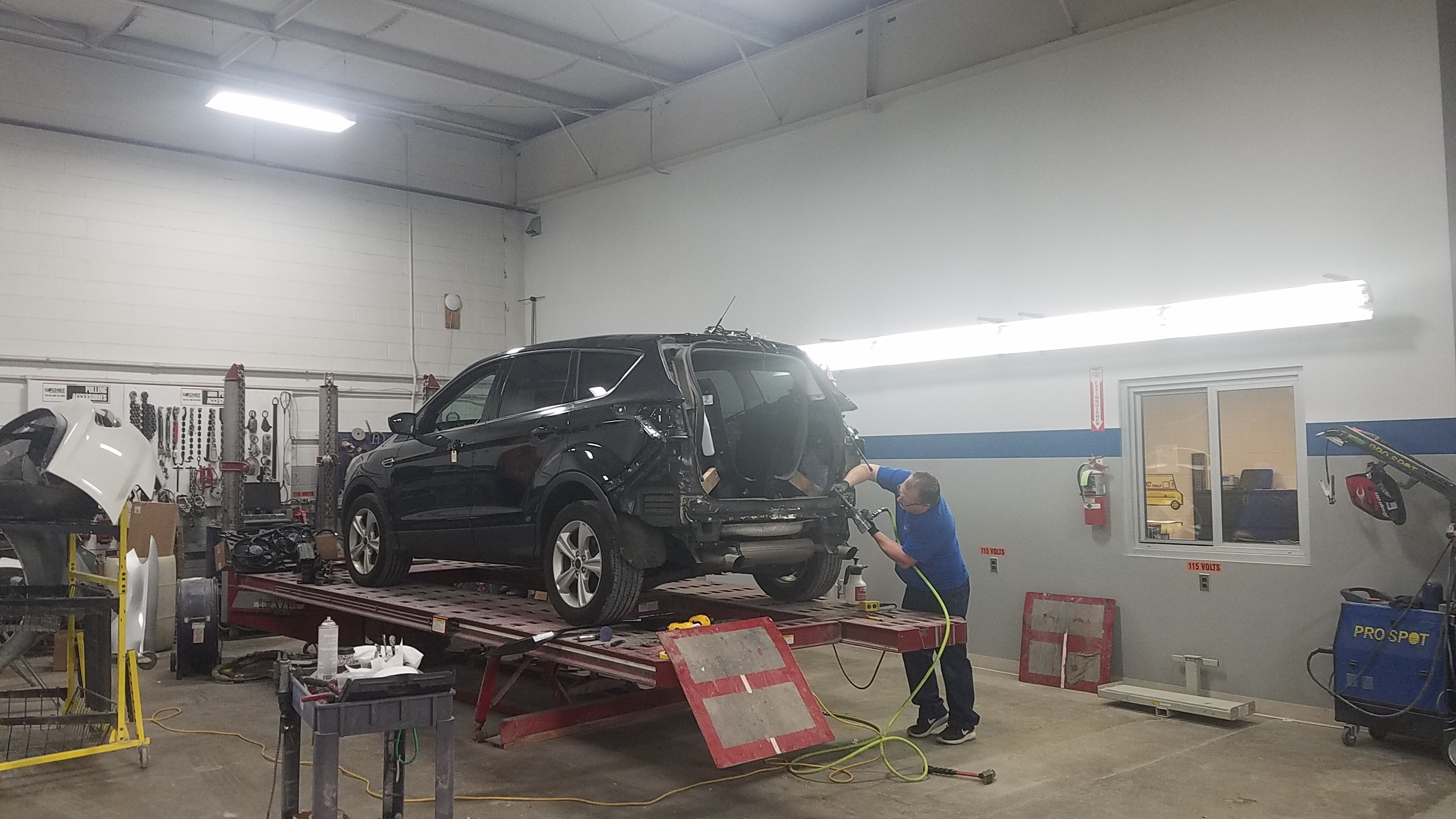 SUV receiving body work in the Stillwell Ford Body Shop in Hillsdale, MI