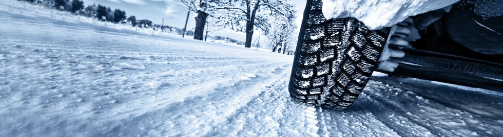 Car Winter Tires on Snow Road Canada