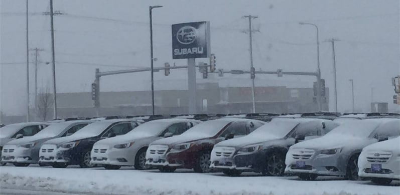 Schulte Subaru with Cars Under Snow Outside the Dealership