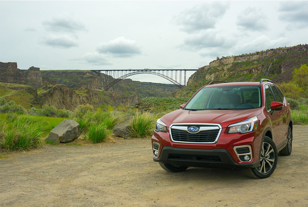 Red Subaru Outback under the Twin Falls Bridge