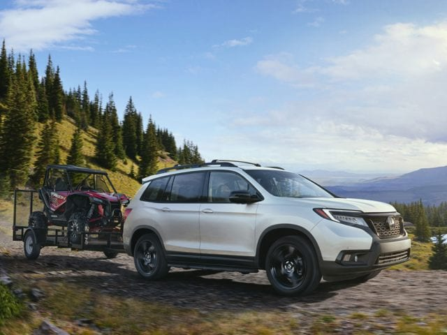 2019 Honda Passport driving through woods