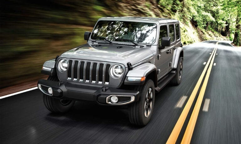 2019 Jeep Wrnalger driving through woods