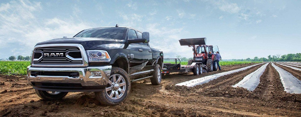 2018 RAM 2500 towing a tractor