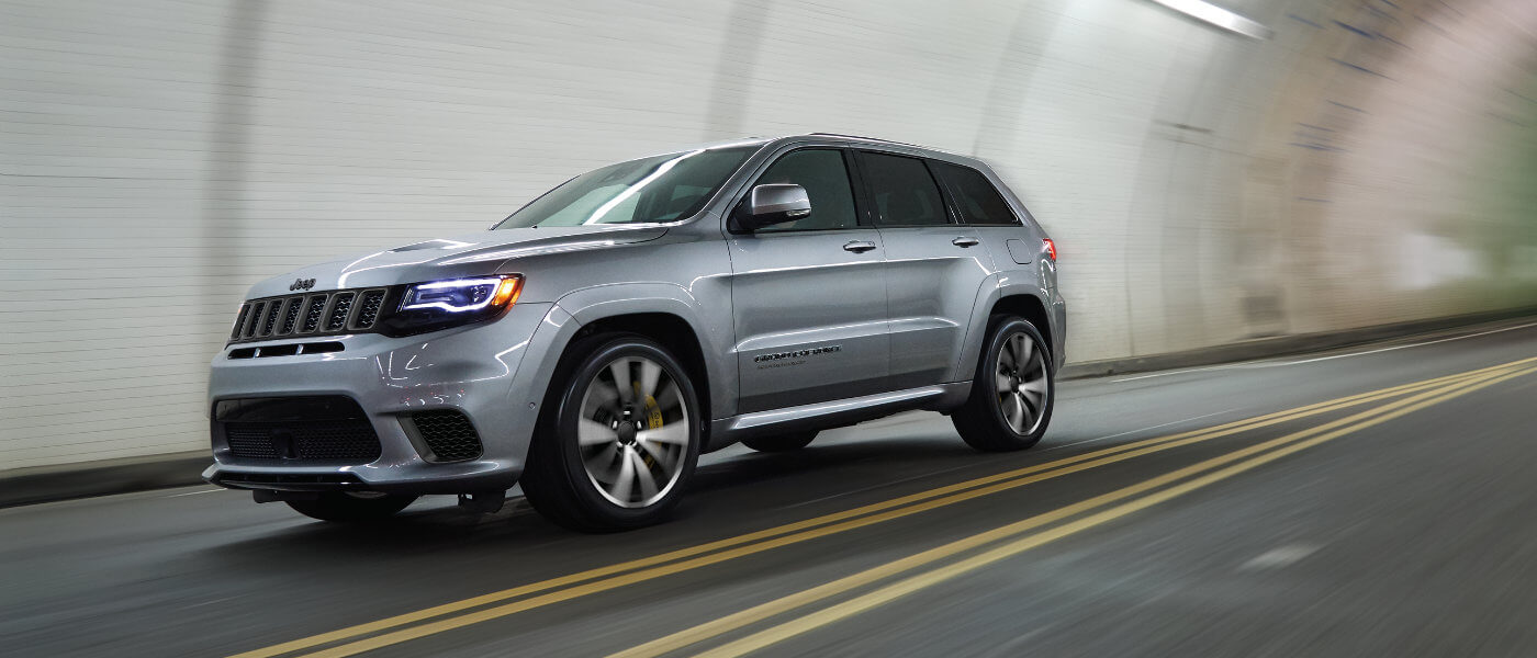 Jeep Grand Cherokee driving through a tunnel