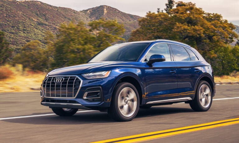 2021 Audi Q5 driving along dessert highway in blue exterior