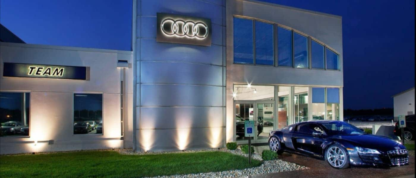 Front of Team Audi Dealership at Night