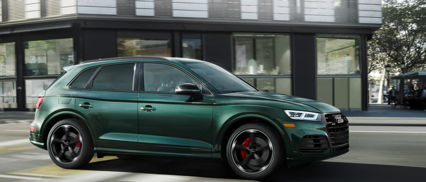 2020 Green Audi SQ5 Driving Past a Building