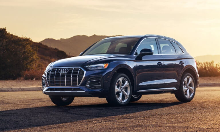 2021 Audi Q5 in blue exterior along sunset