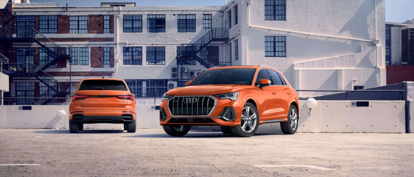 Front & Back 2021 Orange Audi Q3 Parked in Front of a Building