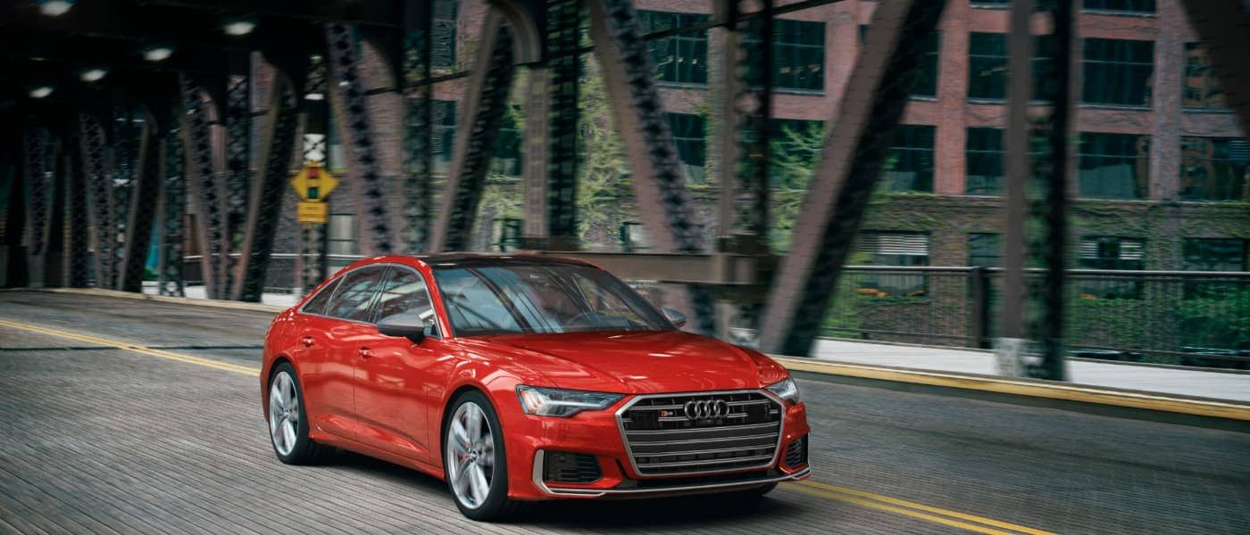 2020 Red Audi S6 Driving Under a Bridge