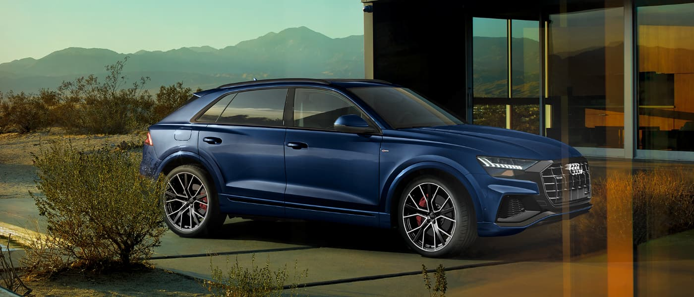 2020 Blue Audi Q8 Parked in Front of a House