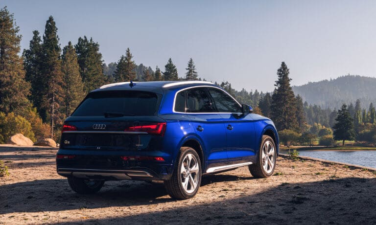 2021 Audi Q5 parked by mountain and lake