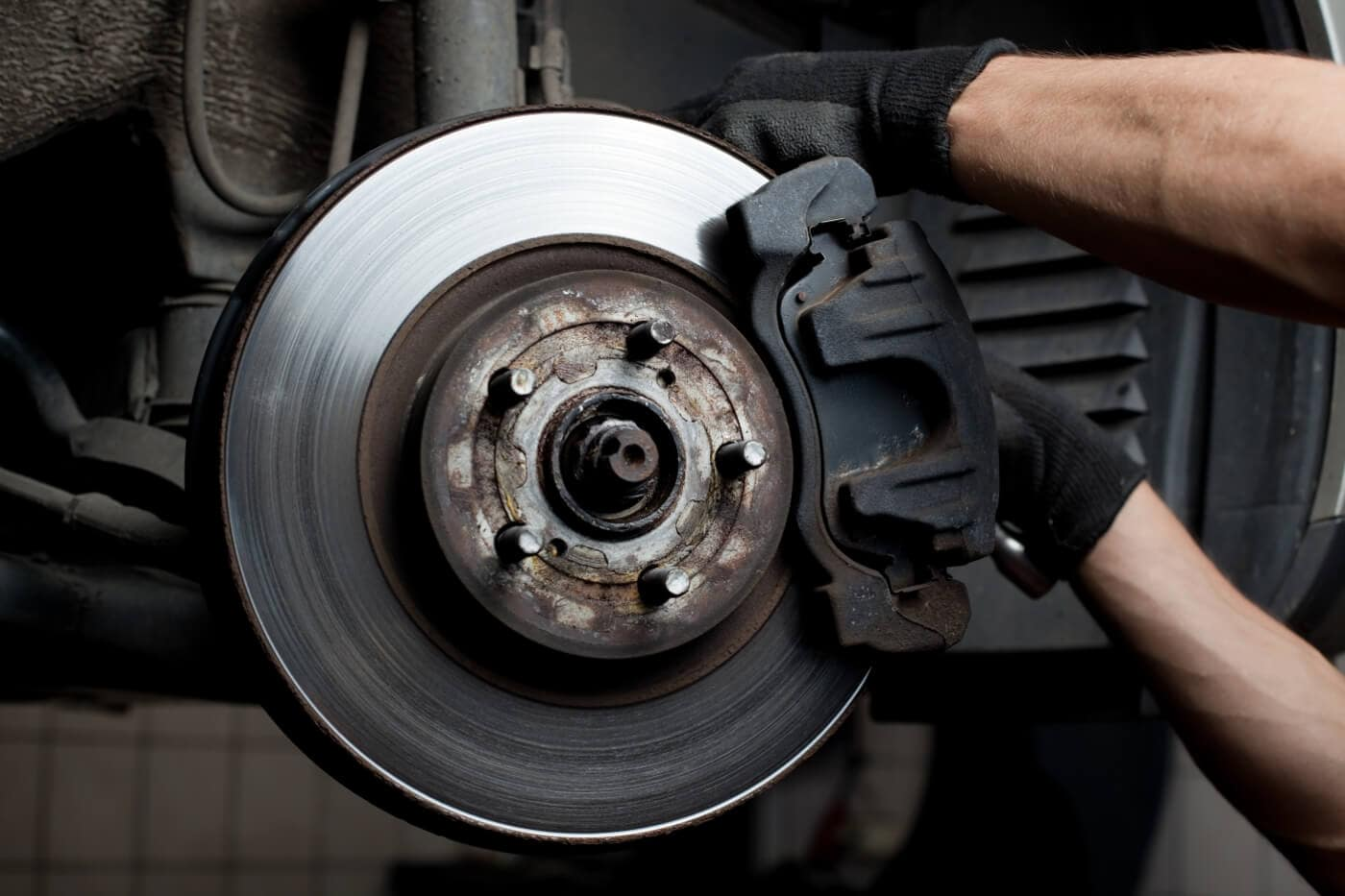 A mechanic putting on new brakes