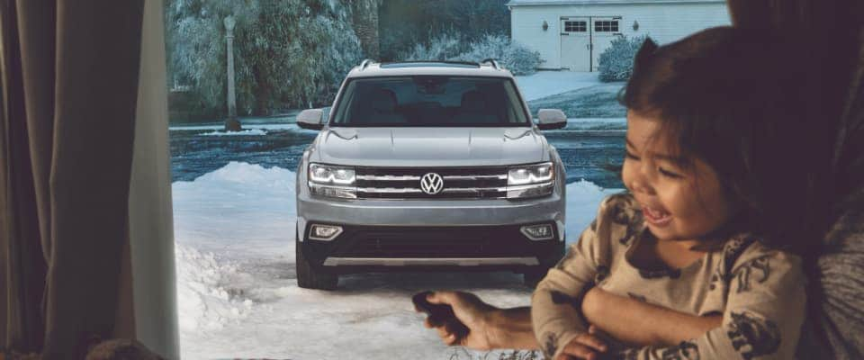 A silver 2019 Volkswagen atlas parked out in a driveway