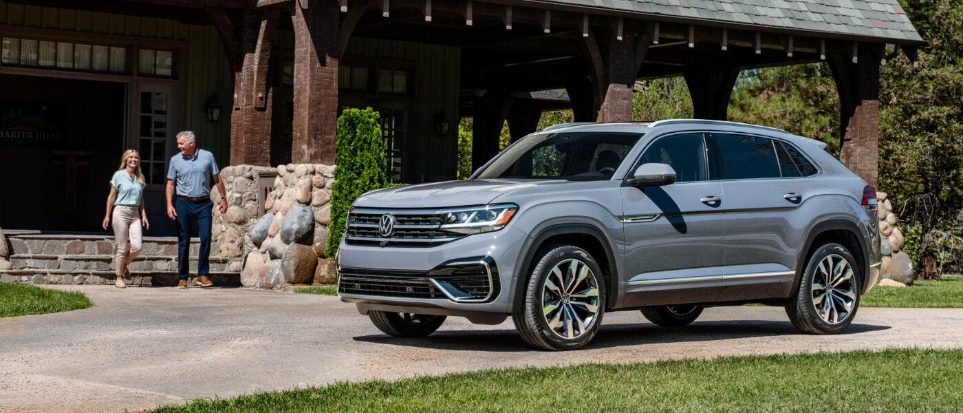 A grey 2020 VW Atlas Cross Sport parked in a driveway