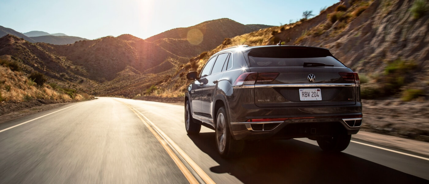 A grey 2020 VW Atlas Cross Sport driving through mountains