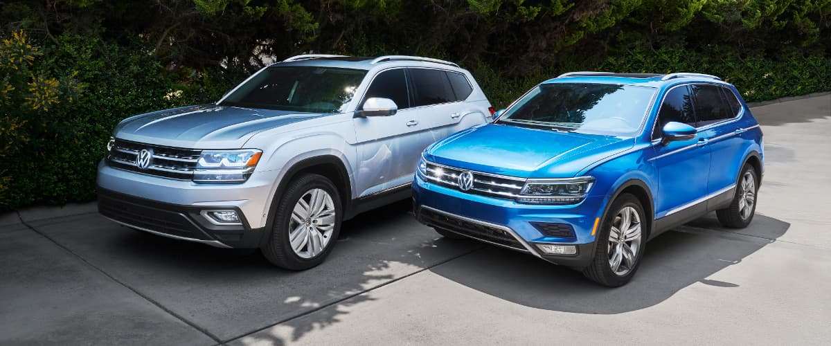 A 2019 VW Tiguan & Atlas parked next to each other in a drive way