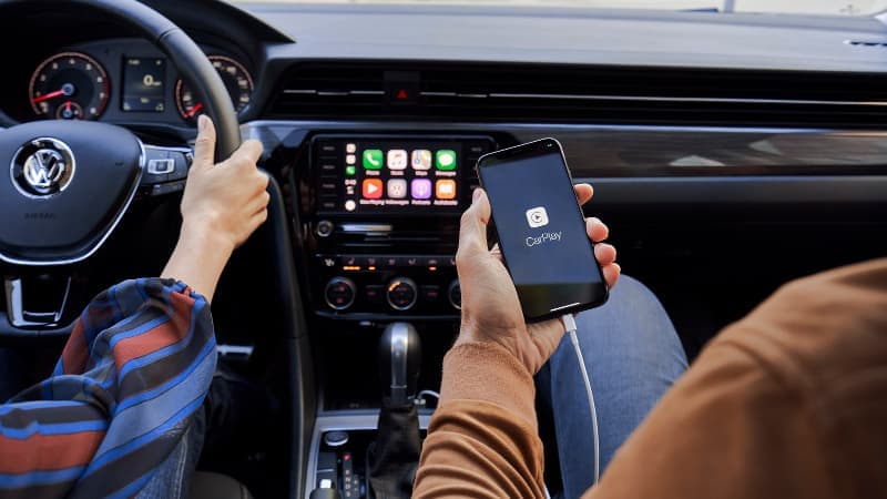 A person syncing their phone with their 2020 VW Passat