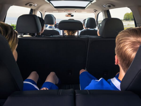 Kids in a VW Atlas going to a soccer game