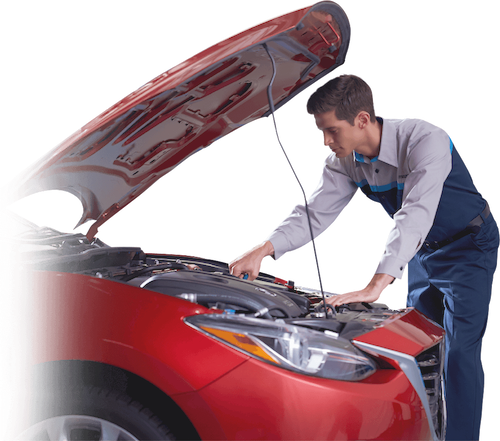 A technician working on a Mazda vehicle