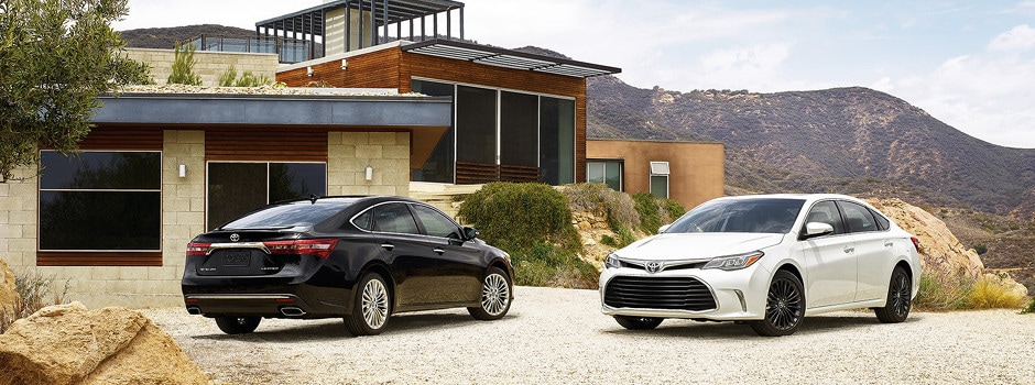 2018 Toyota Avalon parked outside home next to mountains