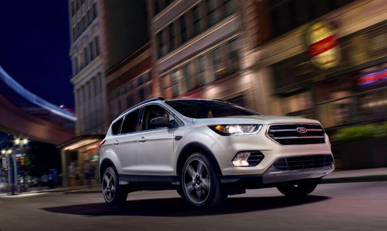 2019 Ford Escape driving in a city at night