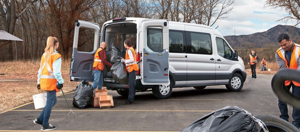 2019 Ford Transit being loaded by a cleaning crew