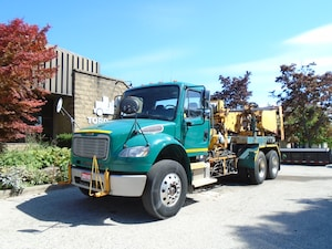 2010 FREIGHTLINER Business Class M2 Rare Cable handling system,Cummins engine,Tandem.
