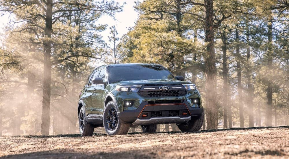 A black 2021 Ford Explorer Timberline is shown in the woods after leaving a Shepherdsville Ford dealer.