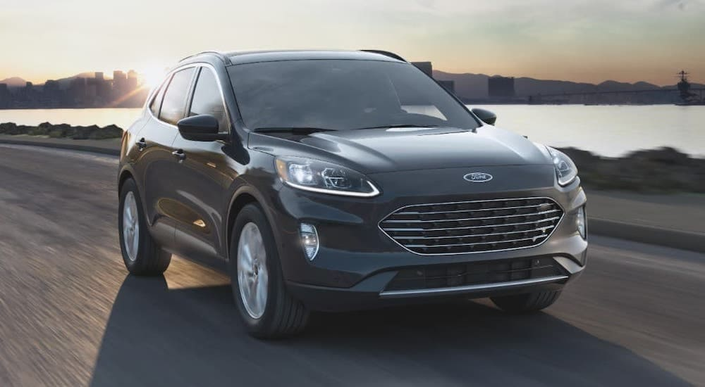 A black 2021 Ford Escape is driving next to a river after leaving a Louisville Ford dealer.