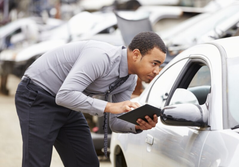 man inspecting cars