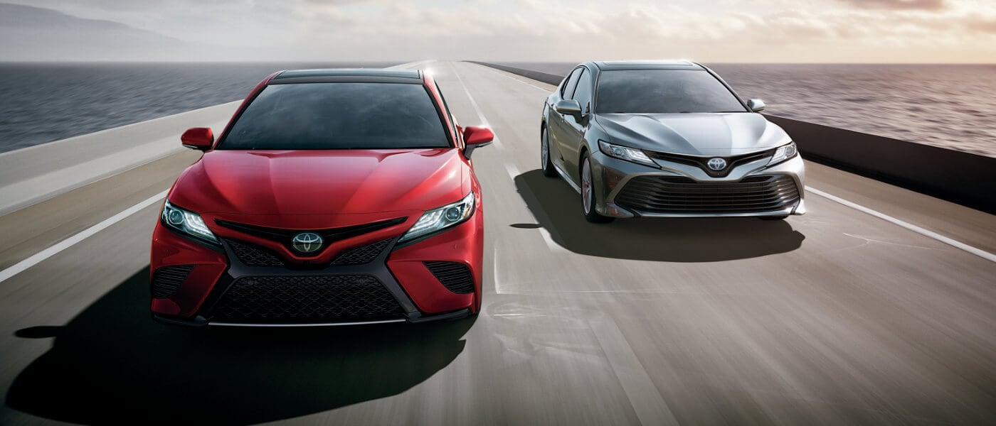 2020 Toyota Camrys driving over bridge over open water