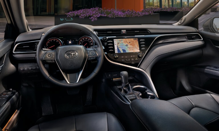 2020 Toyota Camry interior seating showing the front dash