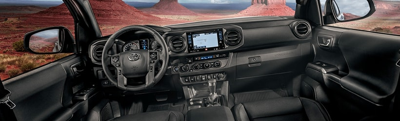 TRD Off-Road Double Cab interior shown in Black leather trim with available Premium and Technology Packages