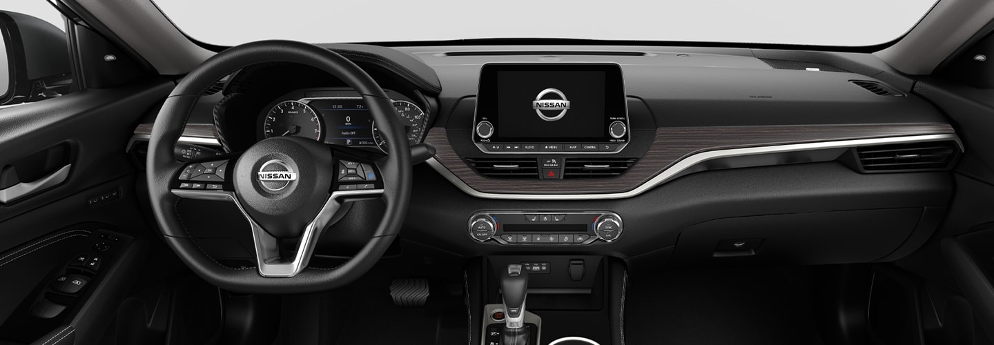 Steering wheel and entertainment center of the 2021 Nissan Altima