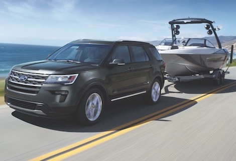 A 2019 Ford Explorer towing a boat