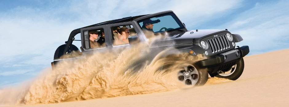 2017 Jeep Wrangler Unlimited driving through sand