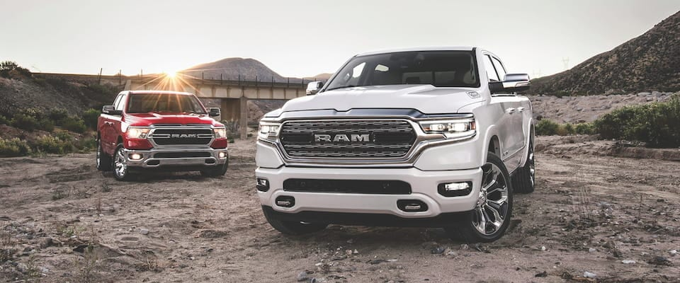 Two 2019 Ram 1500s parked in the mud