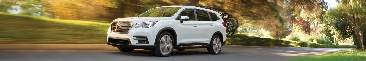 New Subaru Ascent driving through the woods