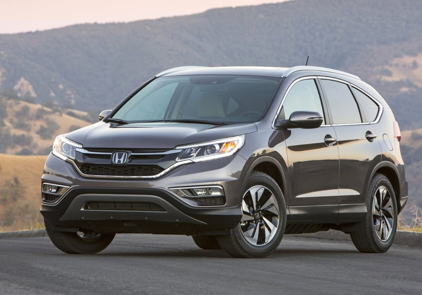 Used 2015 Honda CR-V parked on the side of a road up in the mountains