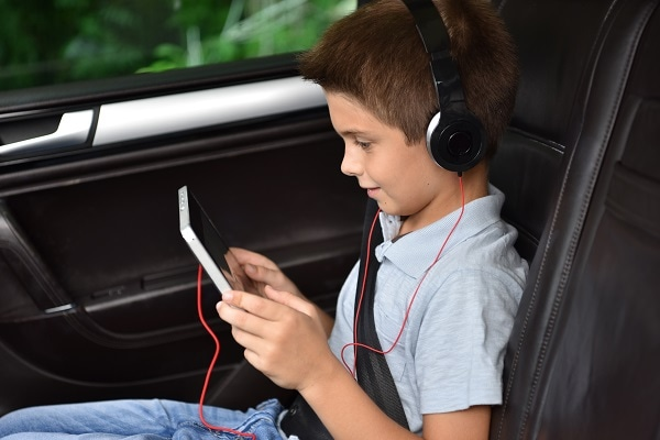 child using tablet in car