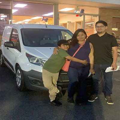 Family with a new Ford Van!