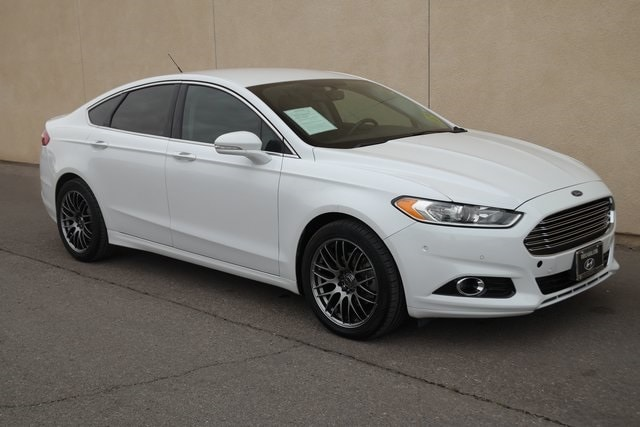 Used cars, trucks, and SUVs 2015 Ford Fusion Titanium Sedan for sale near you in Victorville, CA