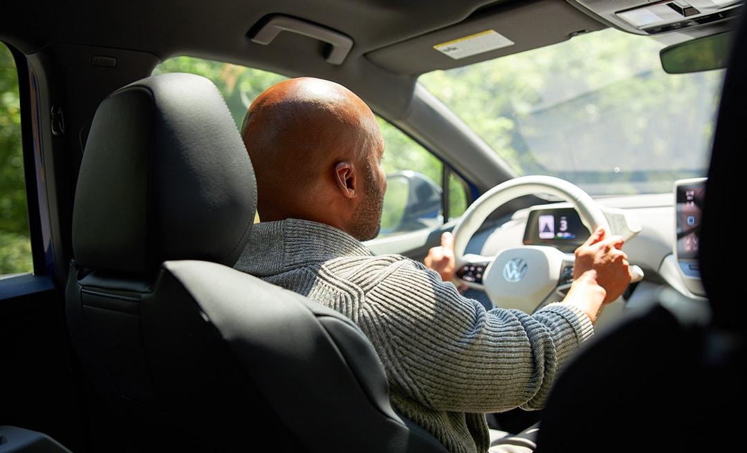 man driving VW's electric car