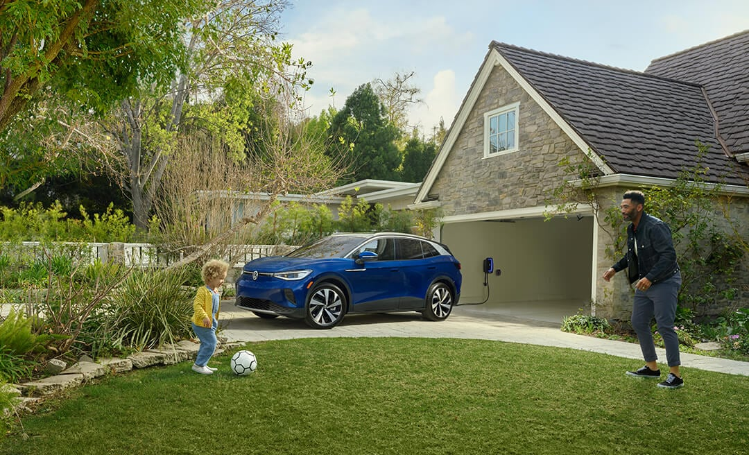 VW electric car parked in driveway