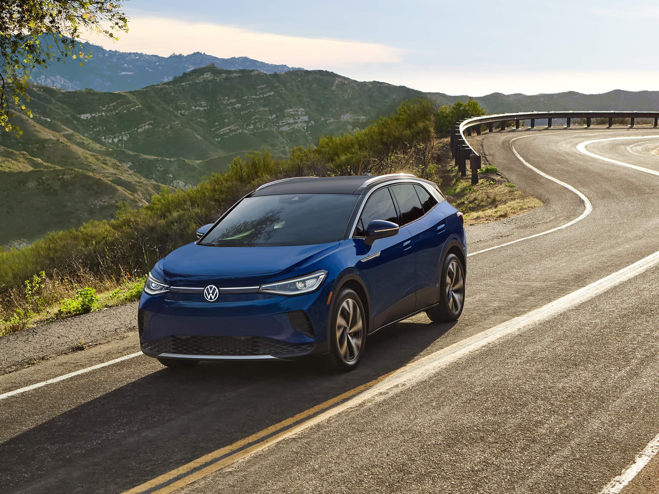 electric car - the id.4 from VW - driving on winding road