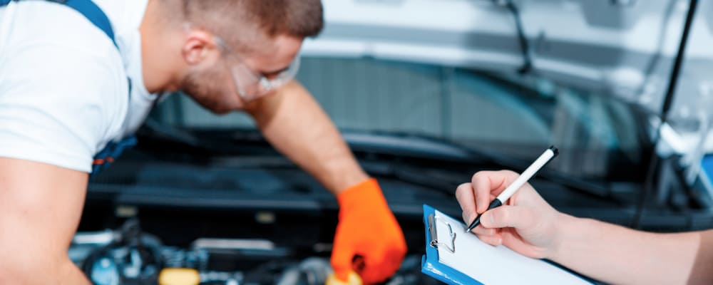 Close up of man servicing a car