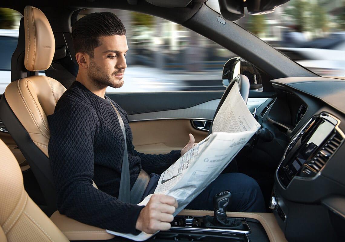 man in autonomous car