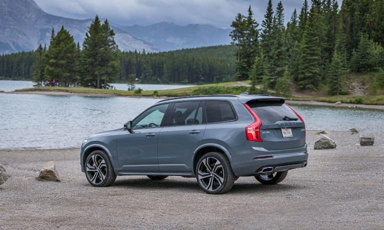 Volvo XC90 parked outside by water